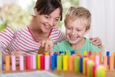 Young boy playing with colorful building blocks — Foto Stock