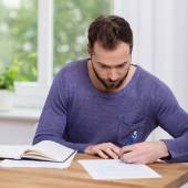 Man working on paperwork at home — Stock Photo