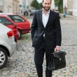 Stylish businessman walking to work — Stock Photo #55781637