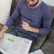 Man relaxing at home reading a newspaper — Stock Photo #55789207