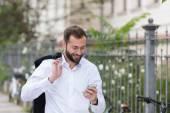Smiling Handsome Man Using Phone While Walking — Stockfoto