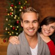 Loving young couple celebrating Christmas — Stock Photo #56431153