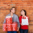 Happy Young Couple Holding Christmas Presents — Stock Photo #56437139