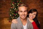 Loving young couple celebrating Christmas — Stock Photo