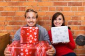 Couple with gifts in their apartment — Stock Photo