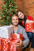Young couple with Christmas gifts — Stock Photo
