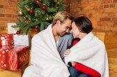 Couple enjoying their christmas eve — Stok fotoğraf