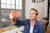 Happy man makes Selfie — Stock Photo