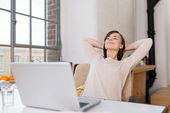 Happy young woman leaning back — Stock Photo