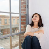 Relaxed woman looking out the window — Stock Photo