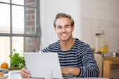 Young man working on laptop — Stock Photo