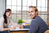 Couple holding holding hands at home — Stock Photo