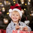 Boy opening an Xmas gift — Stock Photo #58663241