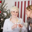 Two girlfriends celebrating christmas — Stock Photo #58663959