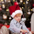 Boy opening Christmas gift — Stock Photo #58664339