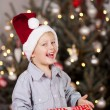 Little boy holding his Christmas gift — Stock Photo #58665099
