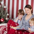 Mother with her children at Christmas — Stockfoto #58665443