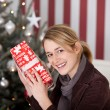 Woman guess contents of gift — Stock Photo #58665603