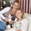 Two sisters celebrating christmas — Stock Photo #58666421