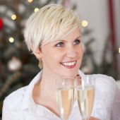 Woman clinking glasses in a toast — Stock Photo