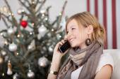 Woman chatting on mobile at Xmas — Stock Photo