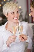 Female friends celebrating Christmas — Stock Photo
