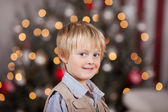 Boy in front of Christmas tree — Stock Photo