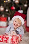 Playful little boy in Santa Hat — Stock Photo