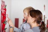 Mom Carrying a Baby Introducing Decors Names — Stock Photo