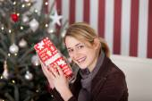 Woman guess contents of gift — Stock Photo