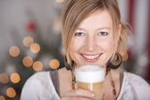 Woman with glass of latte macchiato — Stock Photo