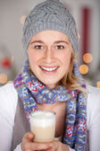 Woman enjoying glass of latte macchiato — Stock fotografie