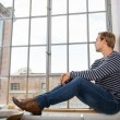 Young man sitting daydreaming — Stock Photo #59070051