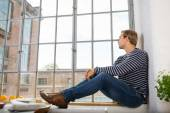 Young man sitting daydreaming — Stock Photo