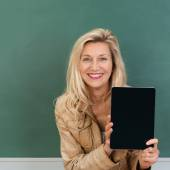 Vivacious teacher displaying blank tablet — Stock Photo