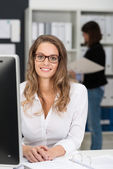 Office Girl in White Looking at Camera — Stockfoto