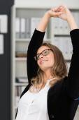 Young businesswoman relaxing at work — Stock Photo