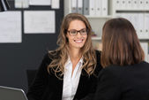 Corporate Woman Taking to Co-worker — Stock Photo