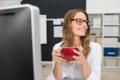 Office Girl Having Coffee at Worktable — Stock Photo
