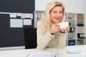 Businesswoman taking break in office — Stock Photo
