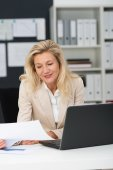 Businesswoman with Laptop at Office — Stock Photo