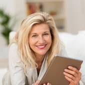 Woman holding tablet — Stock Photo