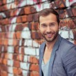 Man Leaning on brick Wall — Stock Photo #61943045