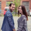 Couple walking hand in hand — Stock Photo #61945809
