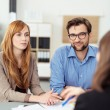 Young couple meeting with a broker — Stock Photo #74339363