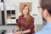 Attractive businesswoman listening to a colleague — Stock Photo