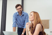 Pensive Office Woman at her Office with Co-worker — Stockfoto
