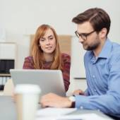 Two colleagues working together at the office — Stock Photo