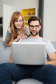 Couple at Home Using Laptop Computer — Stock Photo