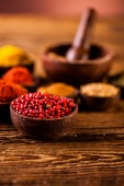 Spices in Indonesian wooden bowls — Stock Photo